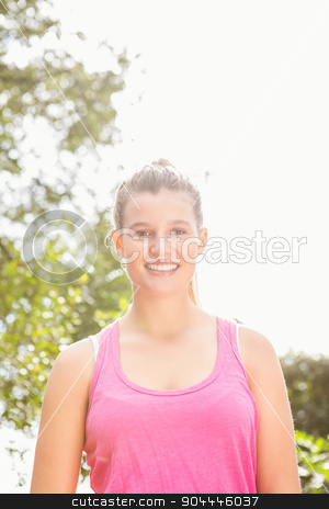 Smiling blonde athlete looking at camera stock photo, Portrait of smiling blonde athlete looking at camera in the nature by Wavebreak Media