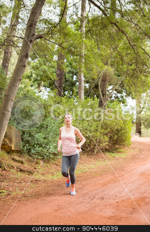 Pretty blonde athlete jogging stock photo, Pretty blonde athlete jogging in the nature by Wavebreak Media
