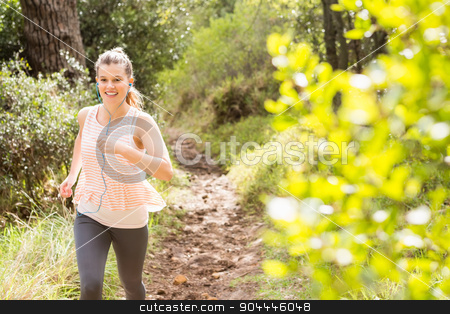 Blonde athlete jogging on trail stock photo, Blonde athlete jogging on trail in the nature by Wavebreak Media
