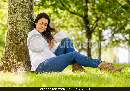 Beautiful brunette relaxing in the park stock photo, Beautiful brunette relaxing in the park on a sunny day by Wavebreak Media