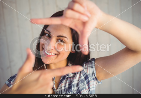 Pretty hipster framing with hands stock photo, Pretty hipster framing with hands on wooden planks background by Wavebreak Media