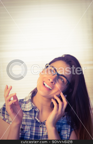 Pretty hipster on the phone stock photo, Pretty hipster on the phone in a bright room by Wavebreak Media