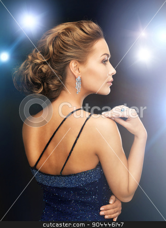 woman with diamond earrings stock photo, beautiful woman in evening dress wearing diamond earrings by Syda Productions
