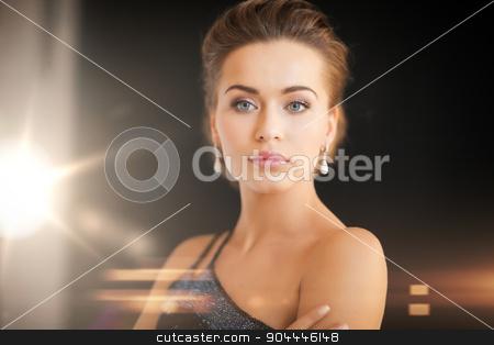 woman with diamond earrings stock photo, beautiful woman in evening dress wearing diamond earrings by Syda Productions