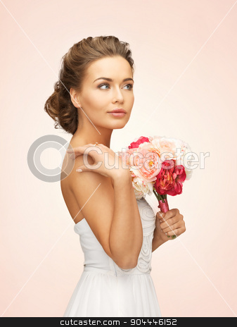 woman with bouquet of flowers stock photo, picture of young woman with bouquet of flowers by Syda Productions