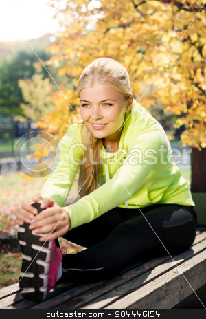 woman doing sports outdoors stock photo, fitness and lifestyle concept - woman doing sports in autumn park by Syda Productions