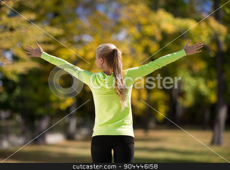 woman doing sports outdoors stock photo, sport, fitness, exercise and lifestyle concept - woman doing sports outdoors by Syda Productions
