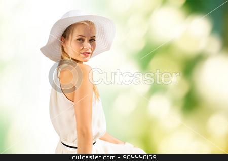 beautiful woman enjoying summer outdoors stock photo, fashion and lifestyle concept - beautiful woman in hat enjoying summer outdoors by Syda Productions