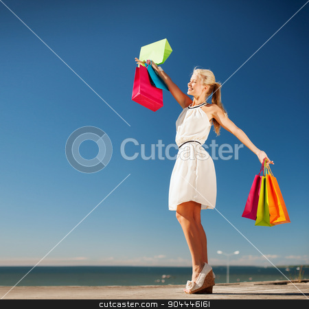 woman with shopping bags stock photo, shopping and tourism concept - woman with shopping bags by Syda Productions