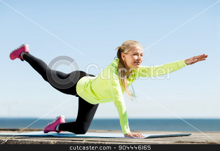 woman doing sports outdoors stock photo, sport and lifestyle concept - woman doing sports outdoors by Syda Productions
