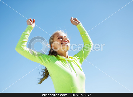 woman runner celebrating victory stock photo, sport and lifestyle concept - woman runner celebrating victory by Syda Productions