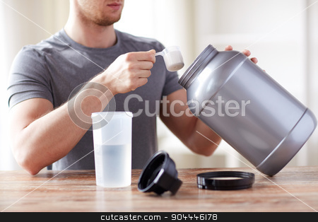 close up of man with protein shake bottle and jar stock photo, sport, fitness, healthy lifestyle and people concept - close up of man with jar and bottle preparing protein shake by Syda Productions
