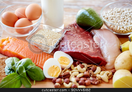 close up of different food items on table stock photo, balanced diet, cooking, culinary and food concept - close up of different foodstuffs on table by Syda Productions