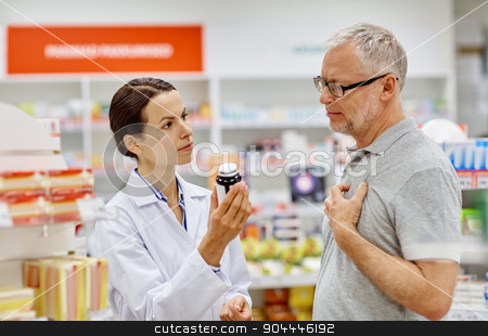 pharmacist showing drug to senior man at pharmacy stock photo, medicine, pharmaceutics, health care and people concept - pharmacist showing drug to senior man customer at drugstore by Syda Productions