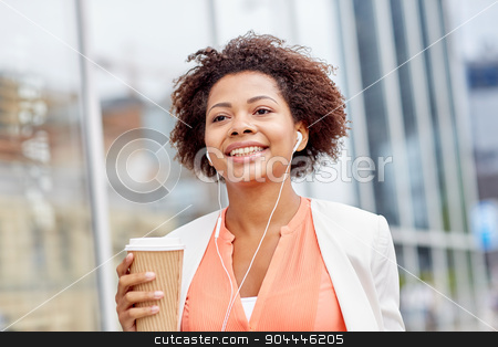 happy african businesswoman with coffee in city stock photo, business and people concept - young smiling african american businesswoman with coffee cup in city by Syda Productions