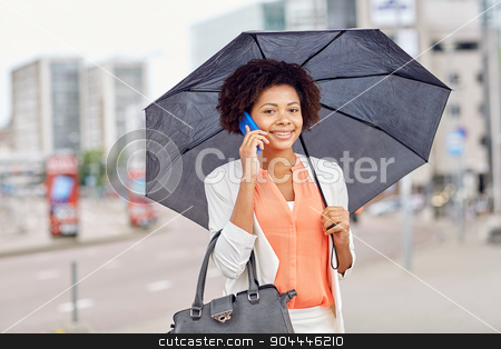 businesswoman with umbrella calling on smartphone stock photo, business, bad weather and people and concept - happy african american businesswoman with umbrella and handbag calling on smartphone at city street by Syda Productions