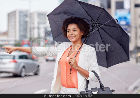 happy african woman with umbrella catching taxi stock photo, business trip, transportation and people concept - young smiling african american woman with umbrella catching taxi at city street by Syda Productions
