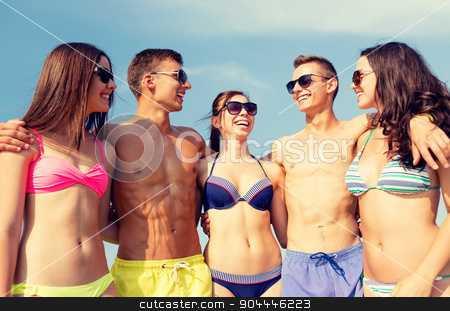 smiling friends in sunglasses on summer beach stock photo, friendship, sea, summer vacation, holidays and people concept - group of smiling friends wearing swimwear and sunglasses talking and laughing on beach by Syda Productions