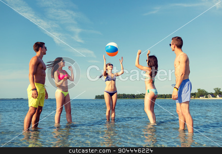 smiling friends in sunglasses on summer beach stock photo, friendship, sea, summer vacation, holidays and people concept - group of smiling friends wearing swimwear and sunglasses talking on beach by Syda Productions