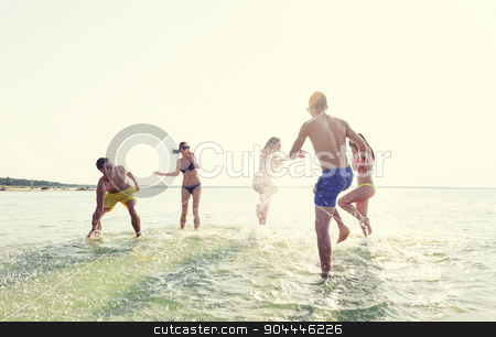 happy friends having fun on summer beach stock photo, friendship, sea, summer vacation, holidays and people concept - group of happy friends having fun on summer beach by Syda Productions