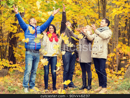 group of smiling men and women in autumn park stock photo, love, relationship, season, friendship and people concept - group of smiling men and women having fun in autumn park by Syda Productions