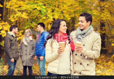 group of smiling friend with coffee cups in park stock photo, love, relationship, season, friendship and people concept - group of smiling men and women walking with paper coffee cups in autumn park by Syda Productions