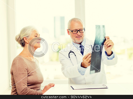 smiling senior woman and doctor meeting stock photo, medicine, age, health care and people concept - smiling senior woman and doctor meeting in medical office by Syda Productions
