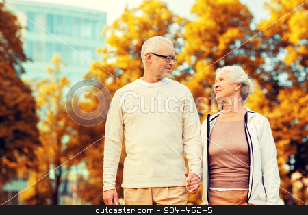 senior couple in city park stock photo, family, age, tourism, travel and people concept - senior couple in city park by Syda Productions
