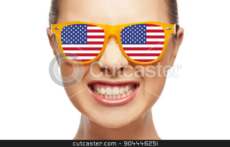 angry teenage girl in glasses with american flag stock photo, people, patriotism, national pride and independence day concept - angry teenage girl in sunglasses with american flag by Syda Productions