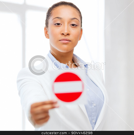 african woman showing stop sign stock photo, business, protest, racism concept - african woman showing stop sign by Syda Productions