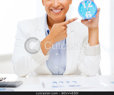 attractive businesswoman pointing at clock stock photo, business, office, time, deadline concept - attractive businesswoman pointing at clock by Syda Productions