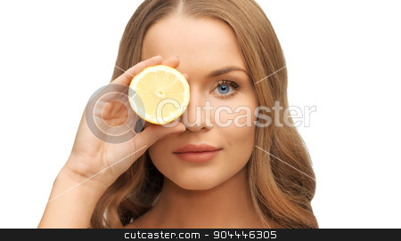 beautiful woman face with lemon slice over eye stock photo, people and beauty concept - beautiful woman face with lemon slice over eye by Syda Productions