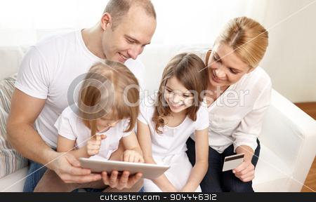 happy family with tablet pc and credit card stock photo, family, online shopping, technology and people - happy family with tablet pc computer and credit card at home by Syda Productions