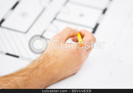 close up of male hand with blueprint and pencil stock photo, building, architecture, construction and people concept - close up of male hand with blueprint and pencil by Syda Productions