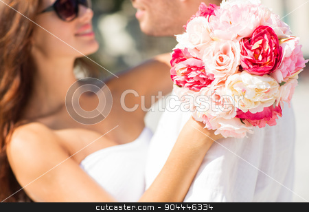 close up of couple with bunch flowers in city stock photo, love, wedding, summer, dating and people concept - close up of couple with bunch of flowers hugging in city by Syda Productions