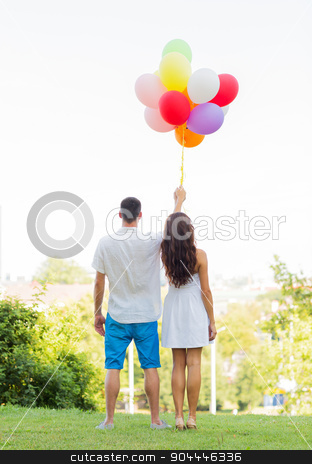 happy couple with air balloons in city stock photo, love, holidays, summer, dating and people concept - happy couple with air balloons in city sitting on bench by Syda Productions