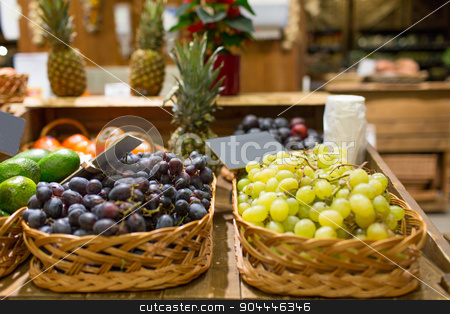 grape in baskets with nameplates at food market stock photo, sale, shopping and eco food concept - ripe red and white grape in baskets with nameplates at grocery market by Syda Productions