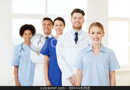 group of doctors and nurses at hospital stock photo, international, profession, people and medicine concept - group of happy doctors and nurses at hospital by Syda Productions
