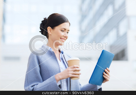 smiling business woman with tablet pc in city stock photo, business, technology and people concept - young smiling woman with tablet pc computer over office building by Syda Productions