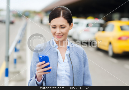 smiling woman with smartphone over taxi in city stock photo, travel, business trip, people and tourism concept - smiling young woman with smartphone over taxi station or city street by Syda Productions
