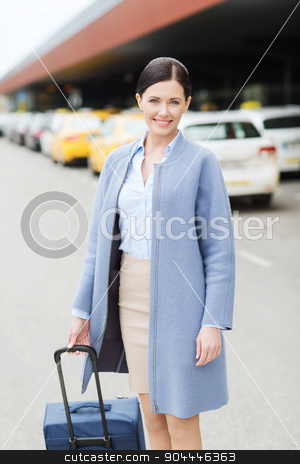 smiling young woman with travel bag over taxi stock photo, travel, business trip, people and tourism concept - smiling young woman with travel bag over taxi at airport terminal or railway station by Syda Productions
