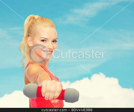 smiling beautiful sporty woman with dumbbell stock photo, fitness, sport and diet concept - smiling beautiful sporty woman with dumbbell by Syda Productions
