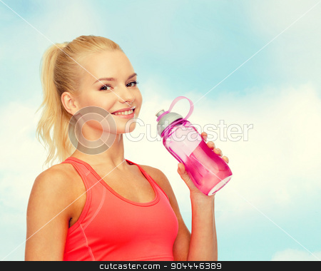 smiling sporty woman with water bottle stock photo, sport, exercise and healthcare - sporty woman with water bottle by Syda Productions
