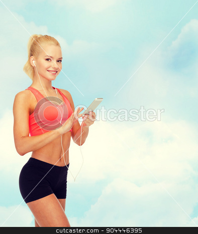 smiling sporty woman with smartphone and earphones stock photo, sport, fitness, technology, internet and healthcare - smiling sporty woman with smartphone and earphones by Syda Productions