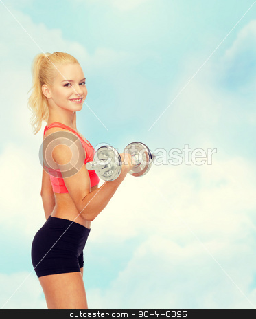 young sporty woman with heavy steel dumbbell stock photo, fitness, healthcare and exercise concept - young sporty woman with heavy steel dumbbell by Syda Productions