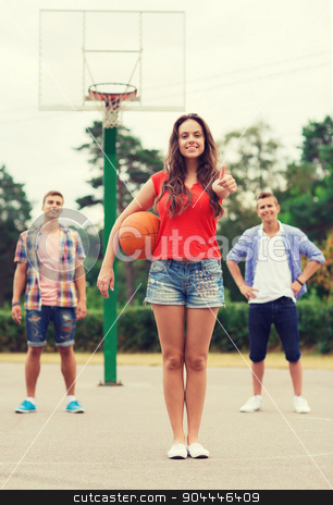 group of smiling teenagers playing basketball stock photo, summer vacation, holidays, games, gesture and people concept - group of smiling teenagers playing basketball and showing thumbs up outdoors by Syda Productions