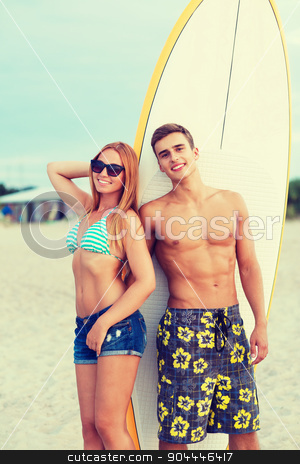 smiling couple in sunglasses with surfs on beach stock photo, friendship, sea, summer vacation, water sport and people concept - smiling couple in swimwear and sunglasses with surfs on beach by Syda Productions