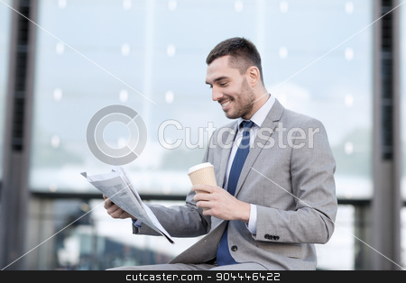 young businessman with coffee and newspaper stock photo, business, hot drinks and people and concept - young smiling businessman with paper coffee cup and newspaper over office building by Syda Productions