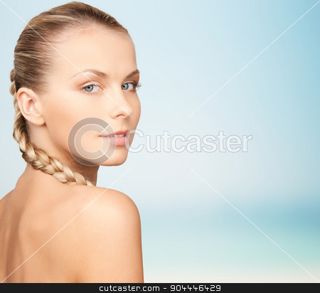 beautiful young woman with bare shoulders stock photo, beauty, people and body care concept - beautiful young woman with bare shoulders over blue background by Syda Productions