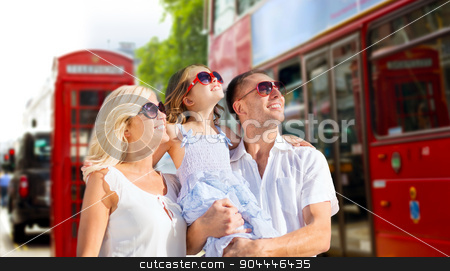 happy family in sunglasses over london city street stock photo, summer holidays, travel, tourism and people concept - happy family in sunglasses looking up over london city street background by Syda Productions